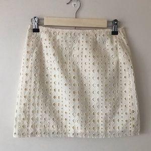 Cream colored geometric lace mini skirt